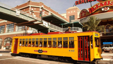 Exterior of a yellow and red electric streetcar