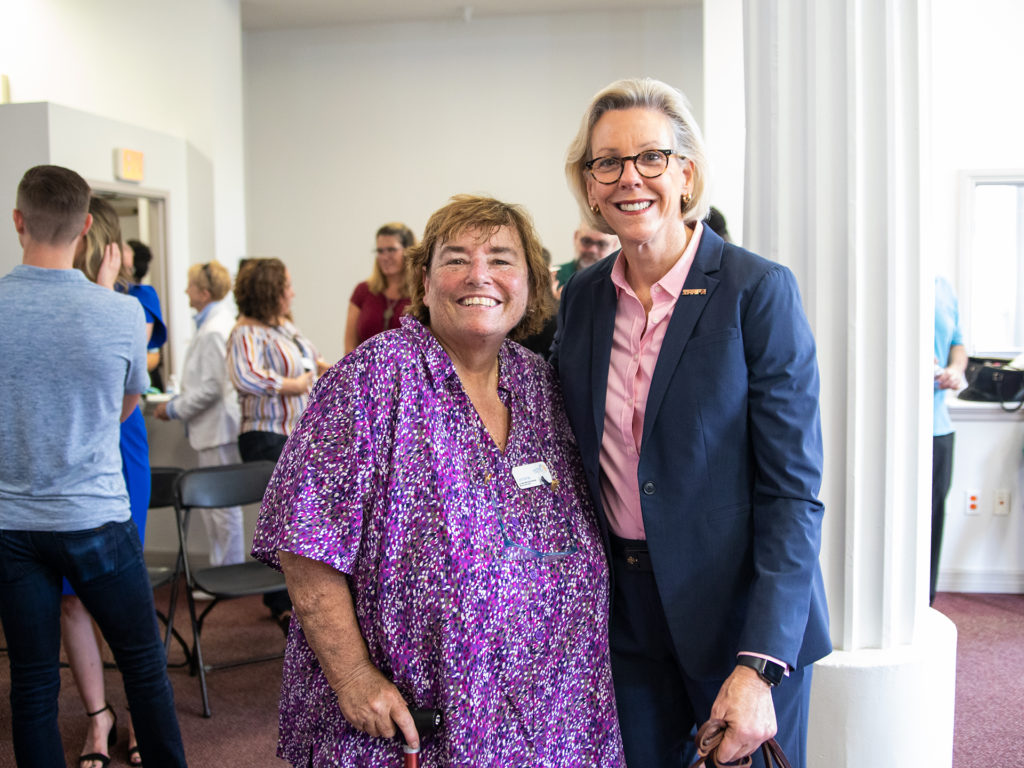 Lorraine Langlois of METRO Inclusive Health and Mayor Jane Castor of Tampa smiling for a picture