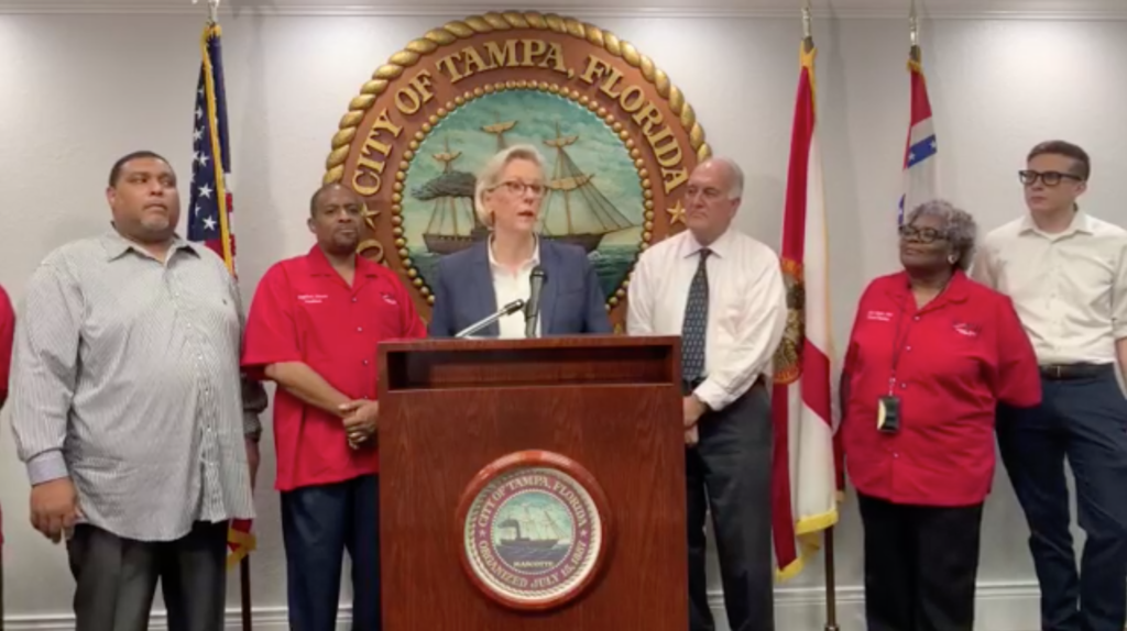 Tampa Mayor Jane Castor stands at a podium during a press conference