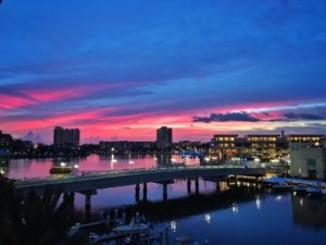 Photo of sunset with pink and blue hues over the water