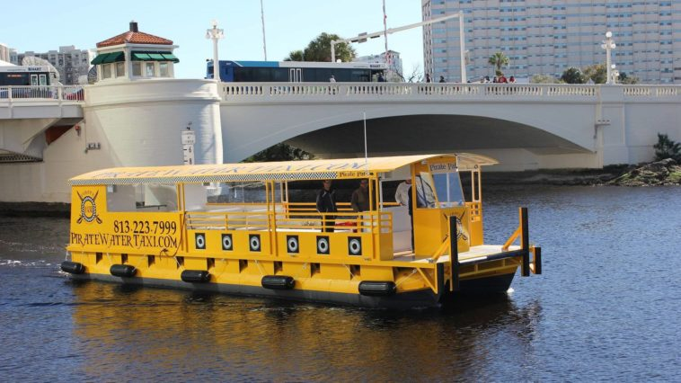 Photo of yellow water taxi boat