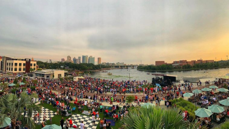 Photo of Tampa residents gathered on the great lawn along the Riverwalk