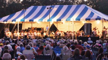 Florida Orchestra assembles on an outdoor stage in Tampa