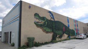 Mural of a bird riding an alligator