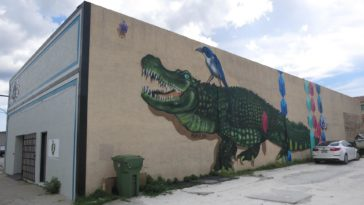 Mural of a bird riding an alligator