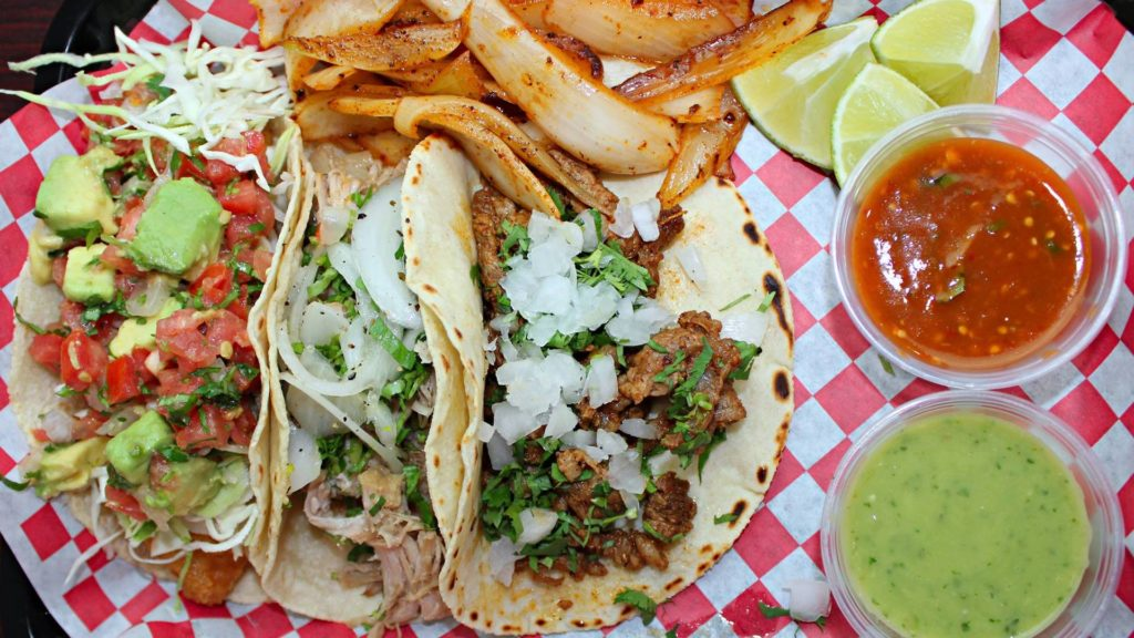 3 different tacos on a red plate