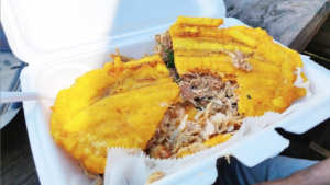 Photo of a pork sandwich with fried plantains as buns