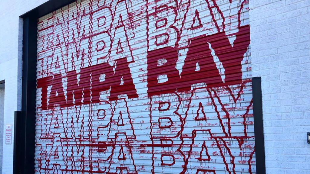 Tampa Bay Mural in red and white on a garage door