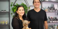 CBD Store owners with their small dog in the store.