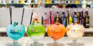 Photo of four brightly colored candy cocktails