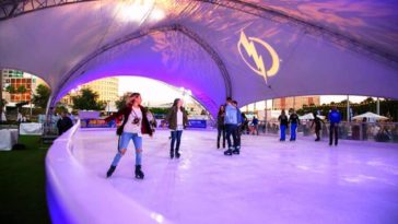 Inside the Curtis Hixon Park waterfront skating rink with purple and blue lights