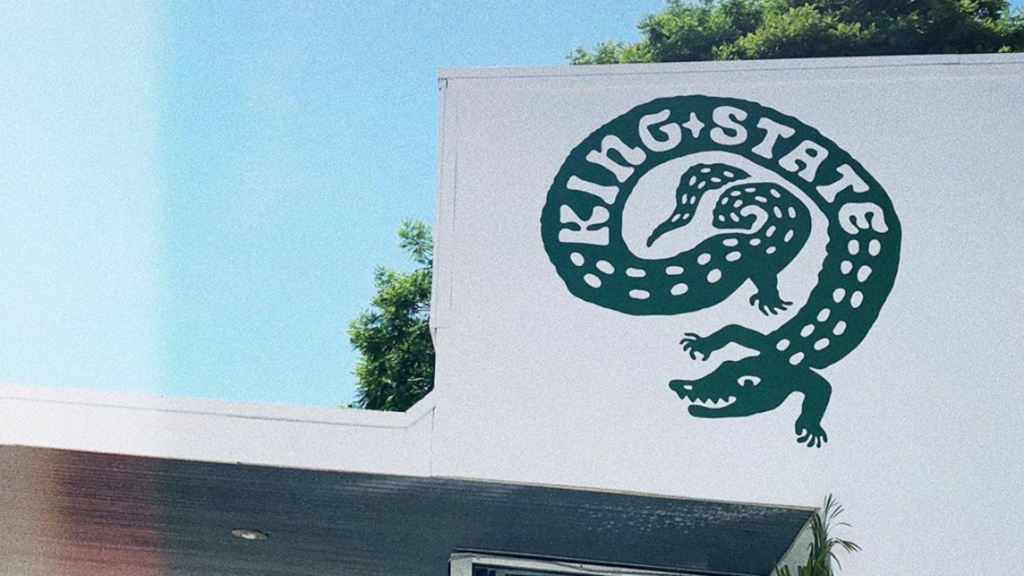 Photo of alligator graphic on the front of a coffee shop