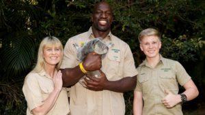 Photo of Titus O'Neil holding a koala