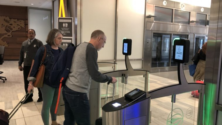 New electronic gates let passengers through at Tampa International Airport