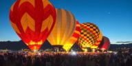 Photo of hot air balloons glowing at night
