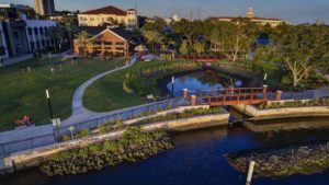 Aerial view of a waterfront restaurant/food hall in the city of Tampa