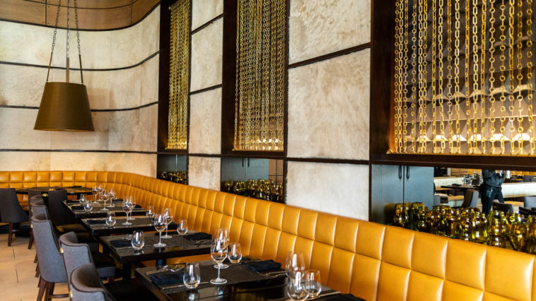 Inside a new steakhouse with gold interiors