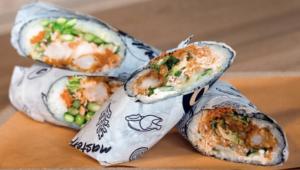 Photo of several sushi burritos