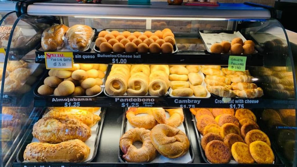 photo of a pastry display case at a Colombian Bakery