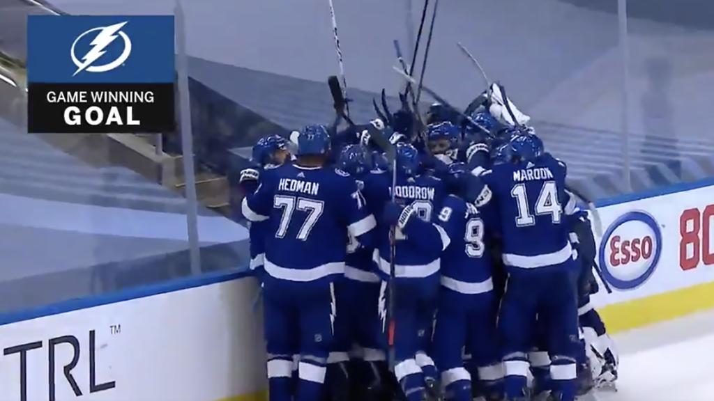 Photo of a hockey team celebrating a goal