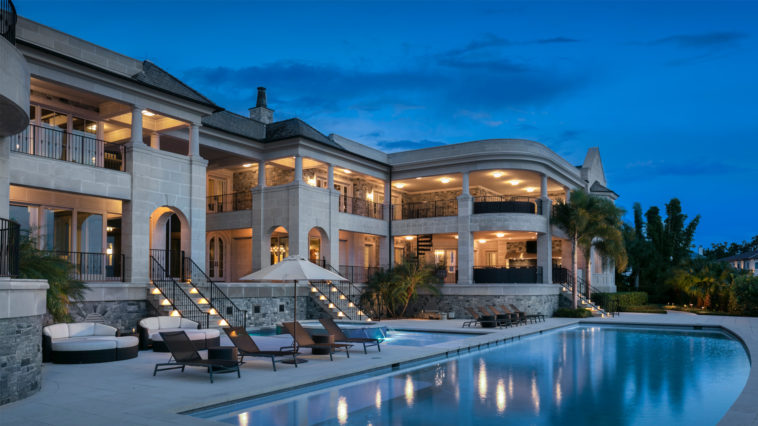 The back of Derek Jeter's home for sale with a view of the pool