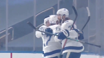 Photo of Lightning players celebrating a goal on the ice