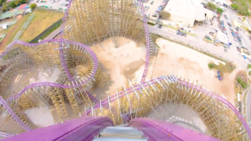 Photo from the top of a massive roller coaster on purple tracks
