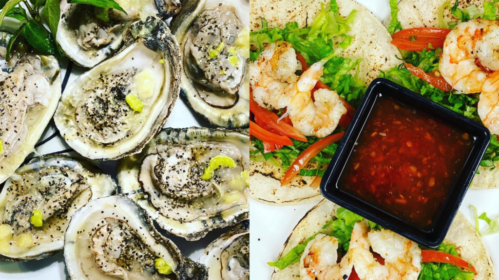 Closeup of grilled oysters and shrimp tacos
