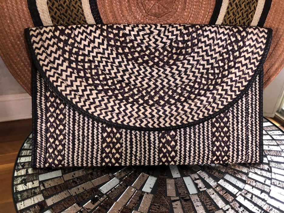 A black and white woven clutch handbag from Sustainable Marketplace