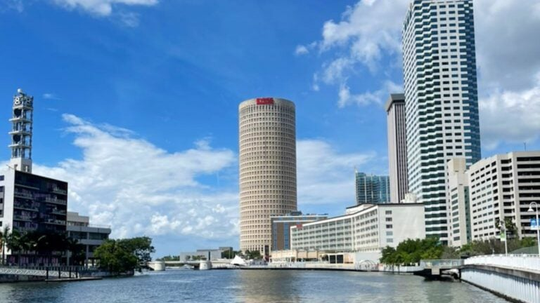 Hillsborough river with a tall cylindrical building in the background
