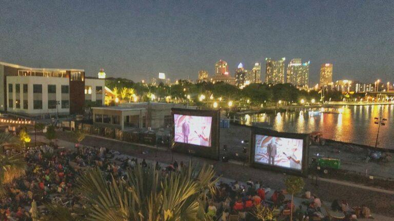 projector screen set up along a Riverwalk