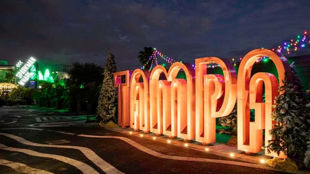 Exterior of a lit up sign that reads Tampa