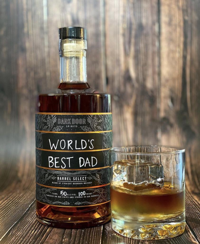 Bottle of dark liquor with a hand written label that reads world's best dad.