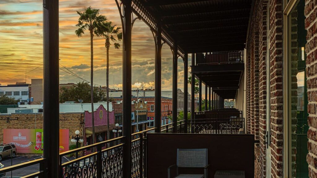 balcony view at sunset from a historic hotel