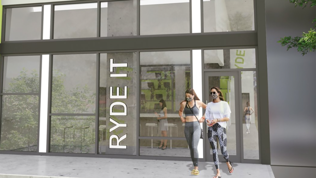 rendering of a spin studio with large glass doors