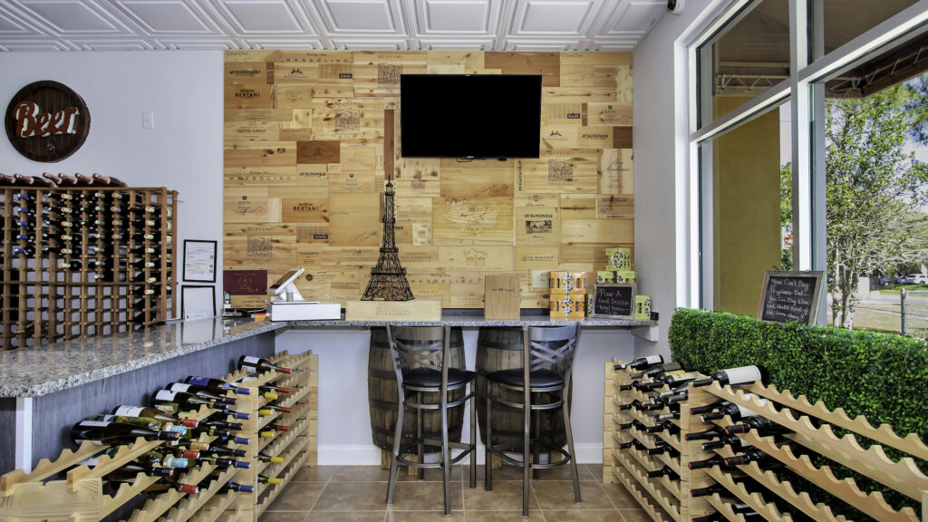 interior of a wine bar with a green wall and wood paneling