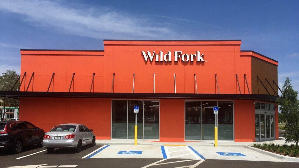 exterior of a grocery store with an orange paint job