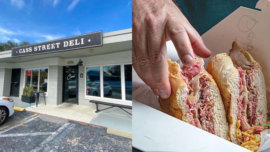 exterior of a deli, with a large sandwich featured