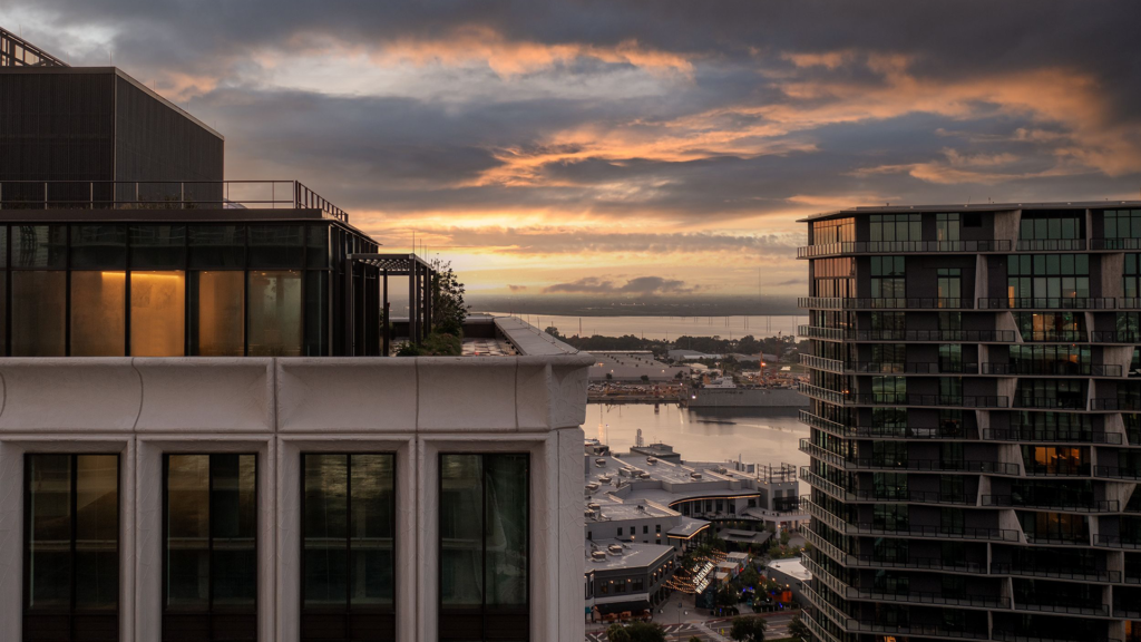 Rooftop photo of three tall buildings at sunset