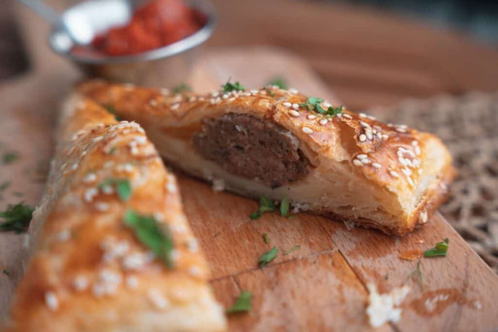 stuffed bread pastry on a wooden cutting board