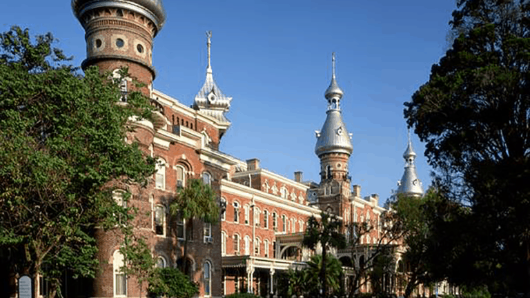 Exterior of a large brick building with minarets