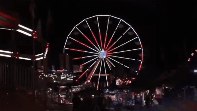 large Ferris wheel lit up at night