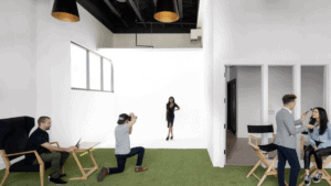 inside a film and photography studio with turf grass and white walls