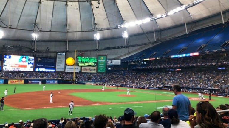 inside a baseball stadium with a covered roof