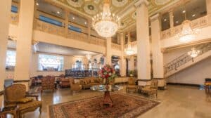 inside a hotel lobby with chandeliers